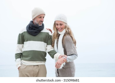 Cute couple standing together at the beach