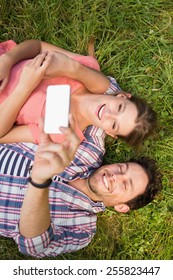 Cute couple taking a selfie on a sunny day