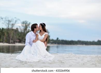 Cute couple wedding ceremony on the beach.