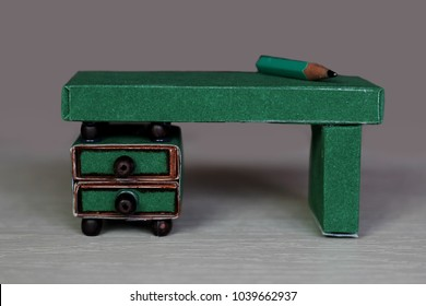 Cute crafted mini desk made with colored paper and match boxes, to create fun and easy with children, concept for preschool and kindergarten