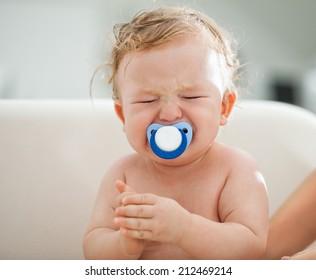 Cute Cucasian baby boy crying.