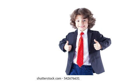 """Cute curly-haired boy in a red tie, looking at the camera and showing hand gestures """"Very good"""". White background."""