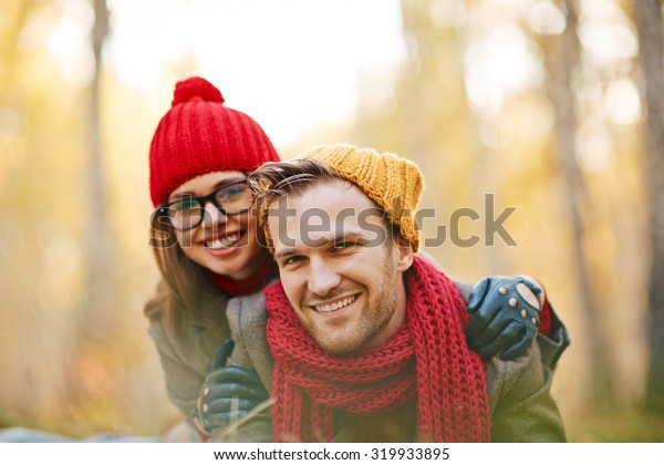 Cute dates relaxing in park