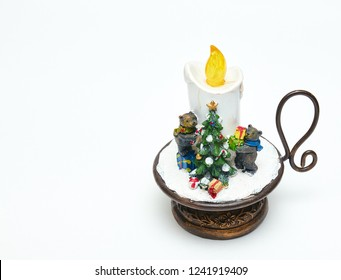 Cute, decorative candle with bears and a Christmas tree. festive decoration. insulator on white background. Christmas and new year symbols. ceramic toy.
