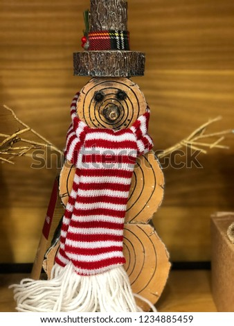 cute decorative snowman made out of wood displayed on a wooden background
