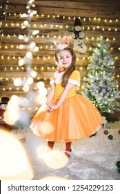 cute dress in orange fox dress at christmas lights