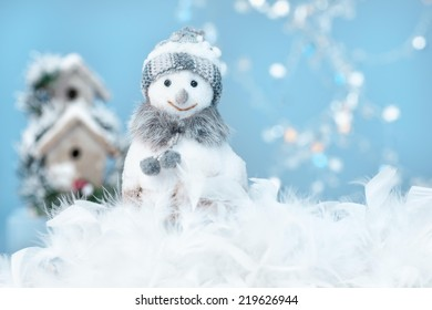 Cute dressed up snowman standing in the snow.