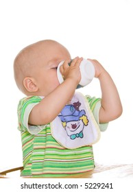 Cute drinking child with cup. Isolated over white