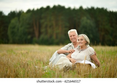 Cute elderly couple walking
