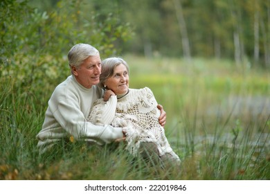 cute elderly couple walking in the park