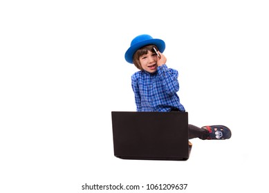 Cute elegant boy talking by phone mobile in front of laptop isolated on white background