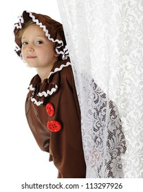 "A cute elementary ""gingerbread girl"" peeking out from behind a lacey white curtain.  On a white background."