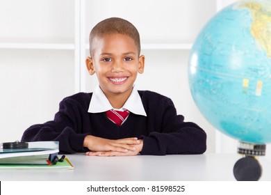 cute elementary schoolboy in classroom