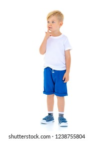 A cute, emotional little boy in a clean white t-shirt. On which you can write a company logo or advertising inscription. The concept of sale and promotion of children's products. Isolated on white