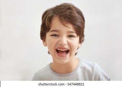 Cute emotional little boy on light blurred background