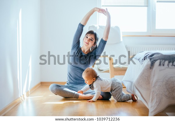Cute European Mother Doing Yoga Pilates Stock Photo (Edit ...