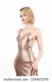 Cute face blond girl with big beautiful eyes, red lips and vintage style hairstyle, wearing a golden sparkling dress. Isolated on white background. Clean, healthy skin. Copy space.