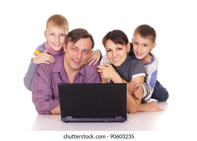 cute family of a four with computer