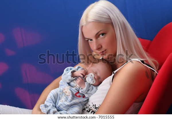 Cute family - mother takes care about angel like child