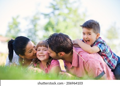 Cute family portrait of 4 people