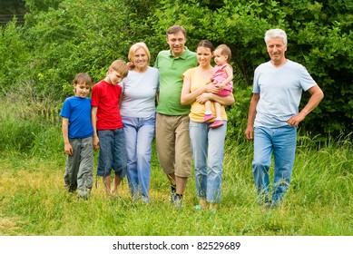 cute family of a seven at nature