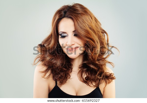 Cute Fashion Model with Red Hair Looking Down