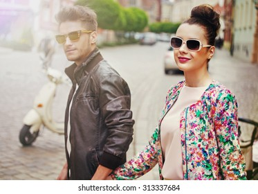 Cute fashionable couple on city street