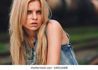Cute fashionable girl. Young and beautiful girl in blue jeans coat.