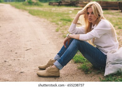 Cute fashionable girl. Young and beautiful girl in blue jeans.