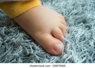 cute feet of baby on carpet