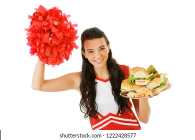 Cute female as an American sports cheerleader, in red and white outfit.  Isolated on white background.