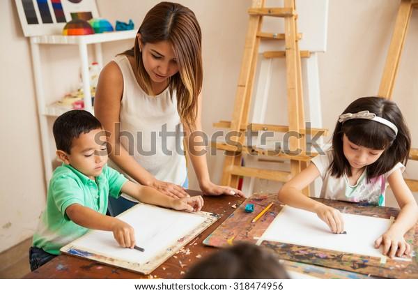Cute Female Art Teacher Helping Her Stock Photo Edit Now