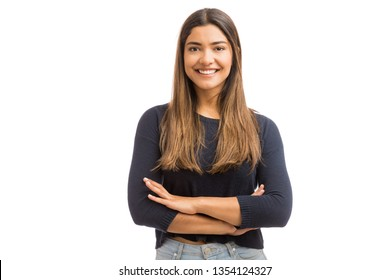 Cute female brunette folding hands while standing over white background