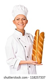 Cute female chef holding up a beautiful loaf of Italian Bread. Isolated on white