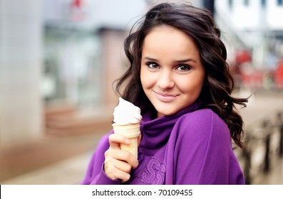 Cute female holding an icecream