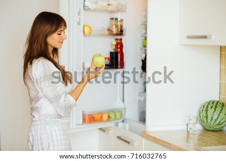 164ffef59fbf Cute Female Pajamas Taking Apple Fridge Stock Photo (Edit Now ...