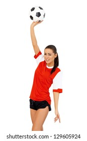 Cute female soccer player standing with one arm raised