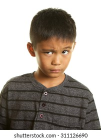 Cute Filipino boy on a white background with a skeptical expression