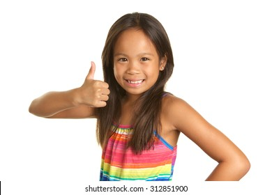 Cute Filipino girl on a white background giving a thumbs up sign with a big smile.