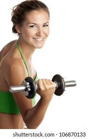 Cute fitness girl working out with dumbbells over white background