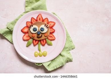 Cute Flower Pancake with berries for kids breakfast