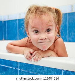 Cute four year old girl taking a relaxing bath. The symbol of purity and hygiene education.