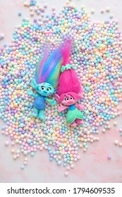 cute friends trolls on pink background. hasbro trolls. concept of children's games, fun, party, toys.