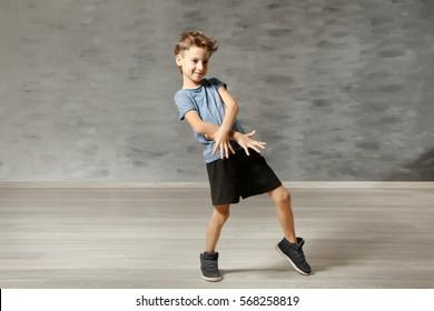 Cute funny boy in dance studio
