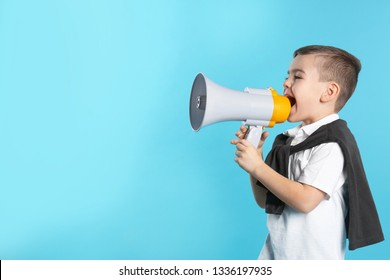 Cute funny boy with megaphone on color background. Space for text
