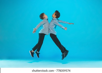 Cute funny boys dancing on blue background