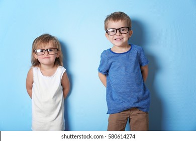 Cute funny children on color background
