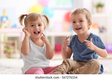 Cute funny children playing at home