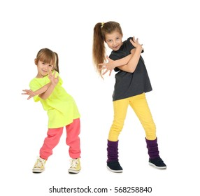 Cute funny girls dancing on white background