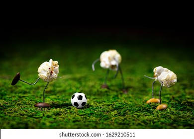 cute funny popcorn figures are playing soccer, football or soccer scene with concept em or championship, celebrated with party snacks